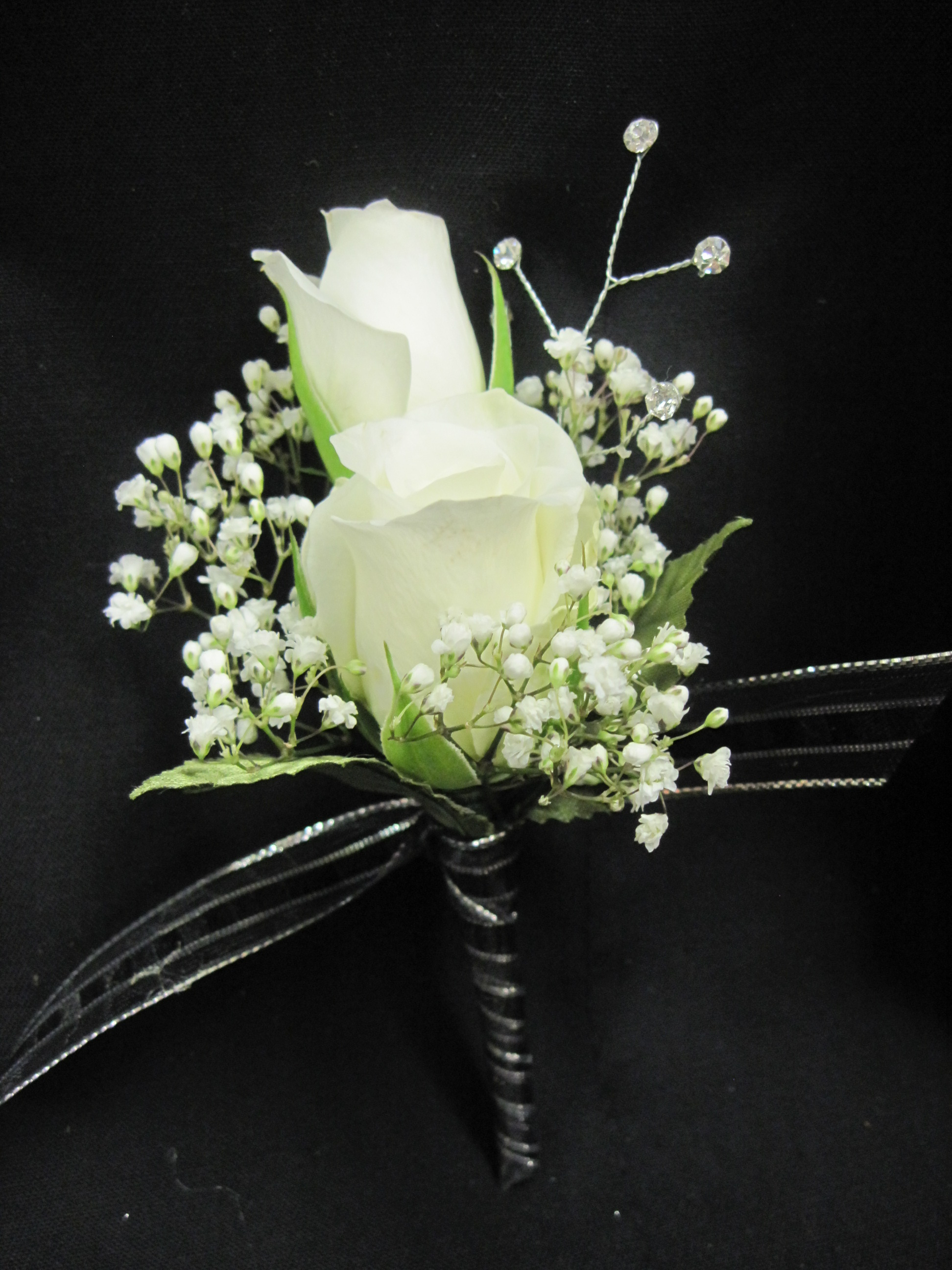 Boutonniere Of White Roses With