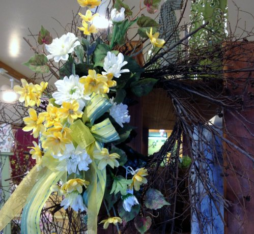 Branchy wreath decorated with mixed yellows and white silk flowers